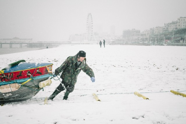 Hardy fisherman in the snow