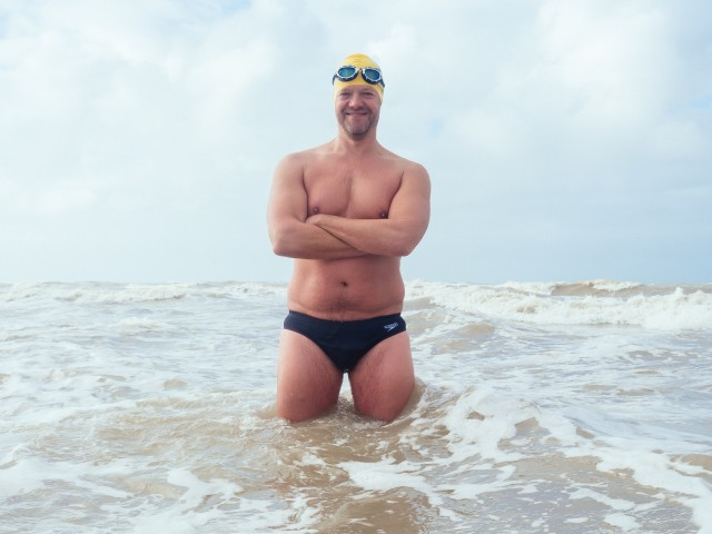 Simon Cooke with his ample body fat that will protect in the cold water.